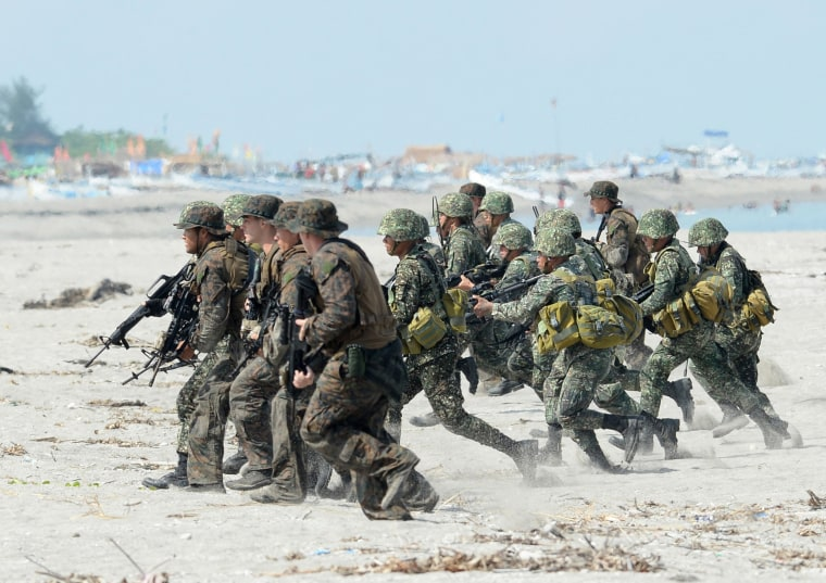 Image: Philippine and U.S. Marines taking positions during a beach assault exercise facing the South China Sea in San Antonio, Zambales province.