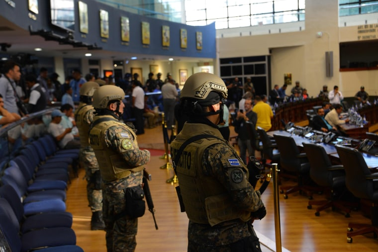 Image: Members of the Salvadoran Armed Forces are seen within the Legislative Assembly during a protest outside the Legislative Assembly to make pressure on deputies to approve a loan to invest in security, in San Salvador