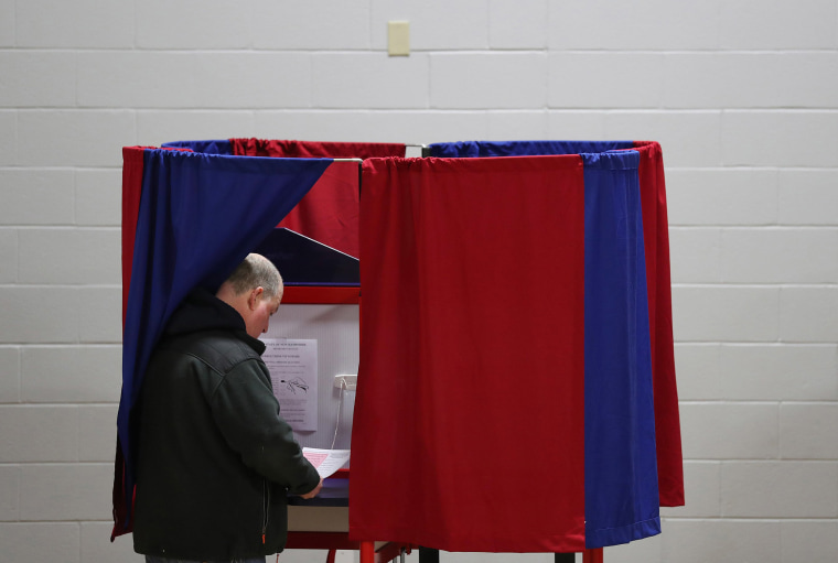 Image: A voter prepares to cast his ballot at a polling station set up in the St. Anthony Community Center on Feb. 11, 2020 in Manchester, New Hampshire.