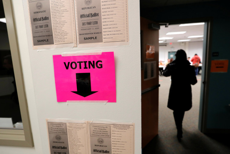 Image: A voter arrives to cast a ballot in the New Hampshire U.S. presidential primary election in Manchester