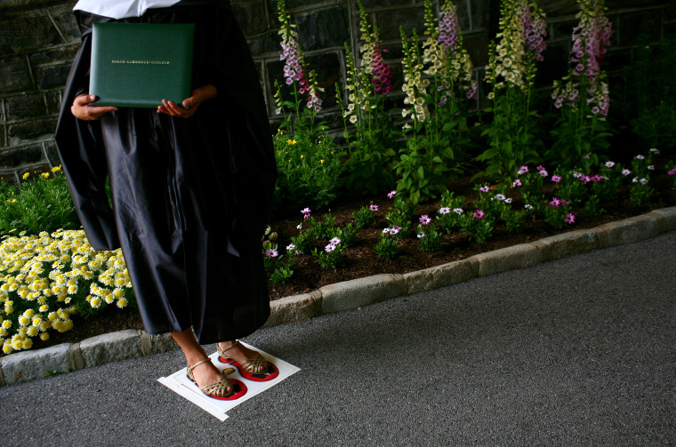 Image: A Sarah Lawrence College graduate poses with her degree in 2009.
