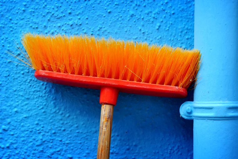 Bold Colours - Orange broom on blue wall, Burano, Venezia