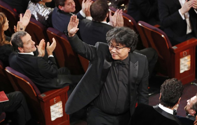 "Bong Joon-ho wins the Oscar for Best Original Screenplay for ""Parasite"" at the 92nd Academy Awards on Feb. 9, 2020."