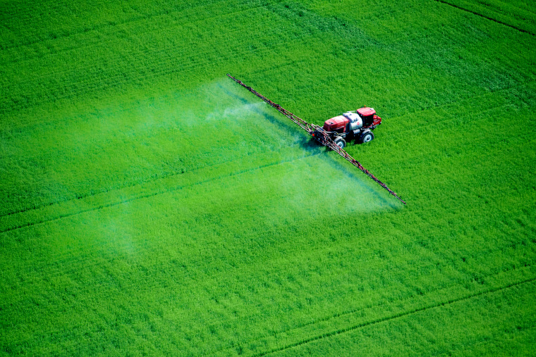 Image: Pesticides are sprayed over a field in Maryland.