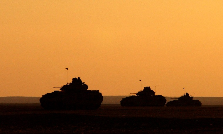 Image: U.S. Army Bradley Fighting Vehicles at sunset in Iraq in 2003.