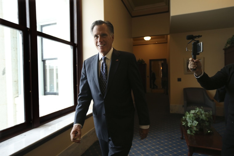 Image: Sen. Mitt Romney, R-Utah, walks through a hallway at the state Capitol in Salt Lake City