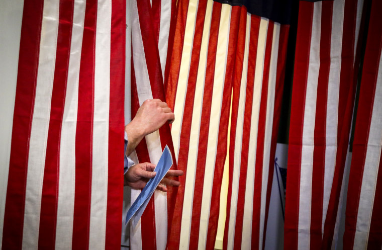 Image: Joe Casey exits a voting booth at the first-in-the-nation midnight voting tradition at Dixville Notch, N.H., on Feb. 11, 2020.