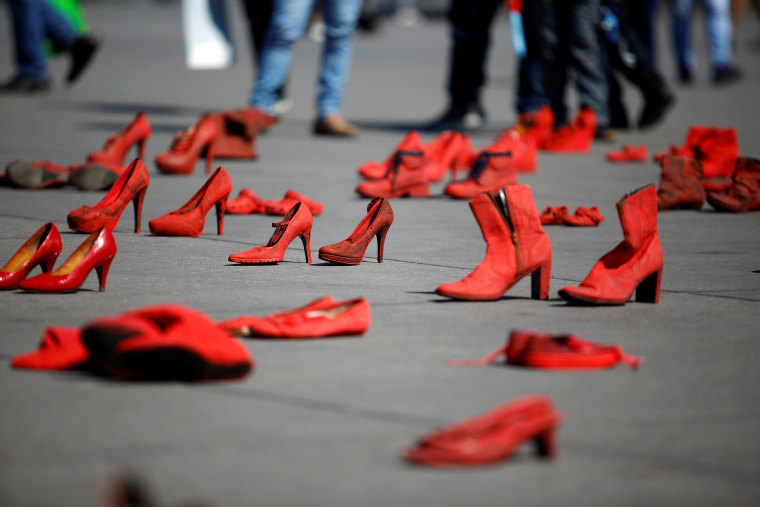 Pairs of women's red shoes, put on display by Mexican visual artist Elina Chauvet to protest against gender violence and femicide, are pictured at Zocalo square in Mexico City