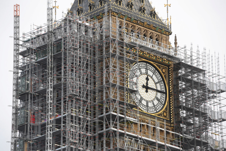 Image: The Elizabeth Tower, housing the Big Ben bell, is seen clad in scaffolding, over the Houses of Parliament, in central London.