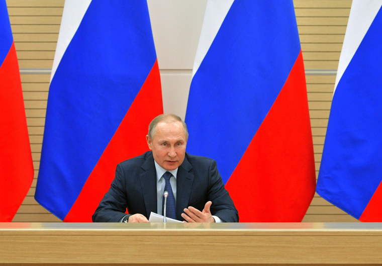 Russian President Vladimir Putin chairs a meeting to discuss changes to Russia's constitution at the Novo-Ogaryovo state residence outside Moscow on Feb. 13, 2020.