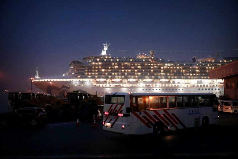 Image: A bus arrives at the Diamond Princess cruise ship where people with COVID-19 are quarantined in Yokohama, Japan, on Feb. 16, 2020.