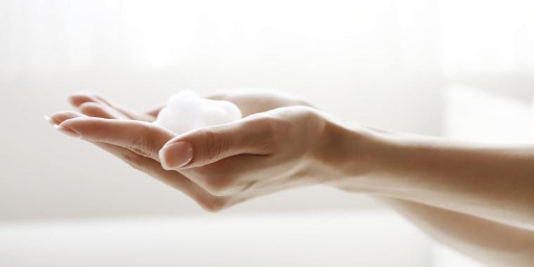Face-wash foam on hands