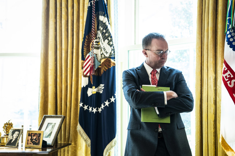 Image: Acting White House Chief of Staff Mick Mulvaney listens in the Oval Office on March 19, 2019.