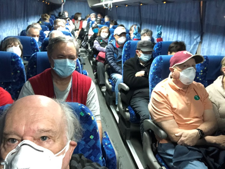 Image: U.S. passengers on board the Diamond Princess cruise ship, who have chosen to leave, are transported by shuttle bus in Yokohama to Haneda airport to fly back to the United States via chartered evacuation aircraft, in Japan