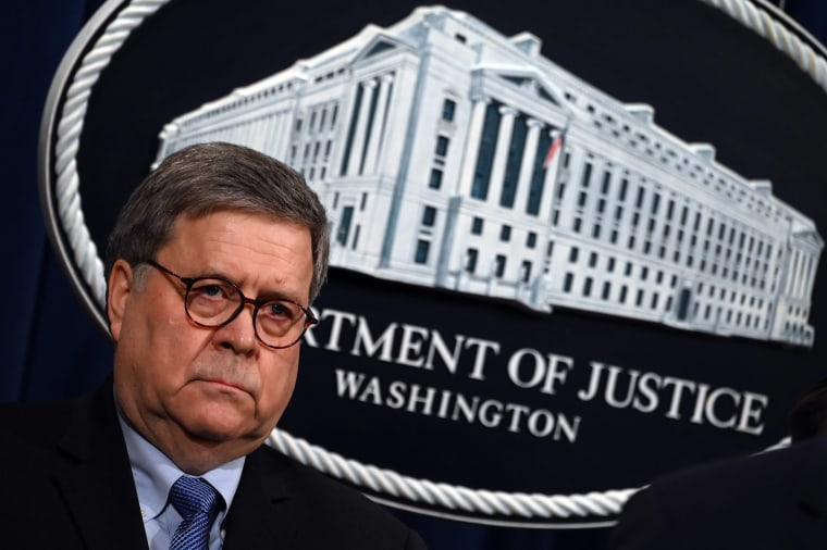 Image: Attorney General William Barr holds a press conference rat the Department of Justice in Washington