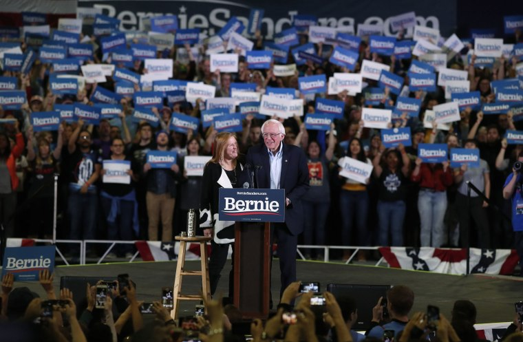 Image: Democratic presidential candidate Sen. Bernie Sanders, I-Vt., jokes with his wife, Jane, during a campaign stop late Sunday, Feb. 16, 2020, in Denver.