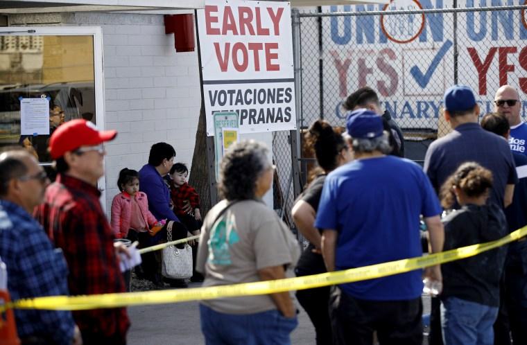 Image: People wait in line to vote early in Las Vegas on Feb. 17, 2020.