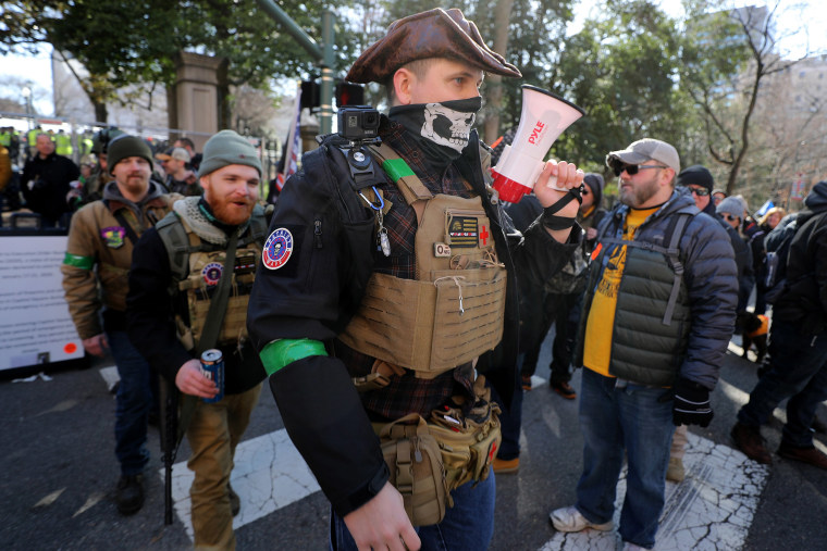 Image: Gun rights advocates wearing body armor and carrying firearms leave a rally organized by The Virginia Citizens Defense League near the State Capitol Building Jan. 20, 2020 in Richmond, Virginia.
