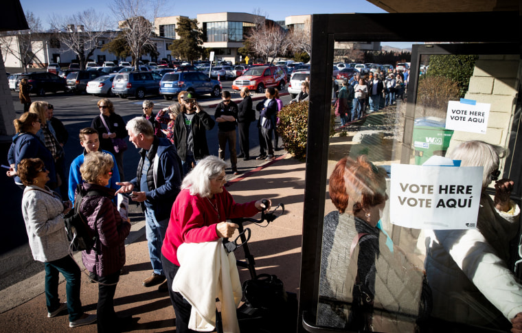 Image: Voters arrive to vote early in the Nevada caucuses in Reno on Feb. 18, 2020.