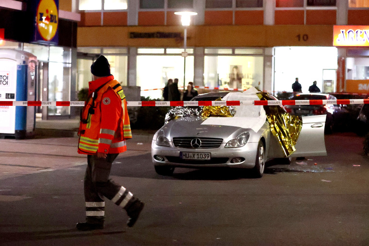 Image: A damaged car is seen after a shooting in Hanau near Frankfurt