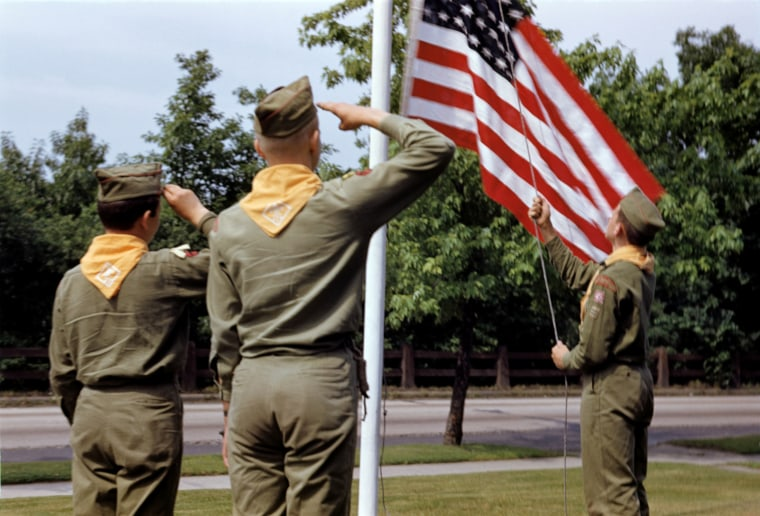 Image: Boy Scouts salute the American flag in 1959.