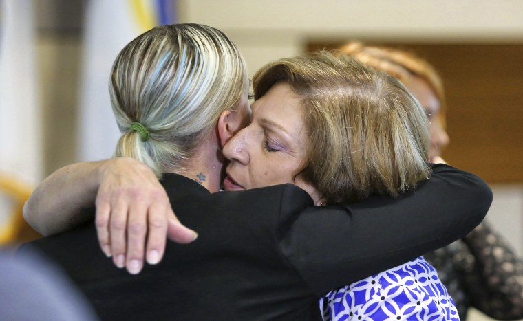 Tina Franke, right, the mother of murder victim Christine Franke, gets a hug from Christine's niece, Ashley, after a press conference on Nov. 5, 2018, at Orlando Police Department headquarters announcing the solving of the cold case from 2001.