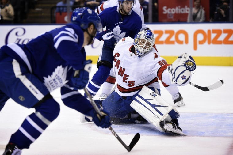Image: Carolina Hurricanes emergency goalie David Ayres attempts to block a shot during a game against the Toronto Maple Leafs on Feb. 22, 2020.