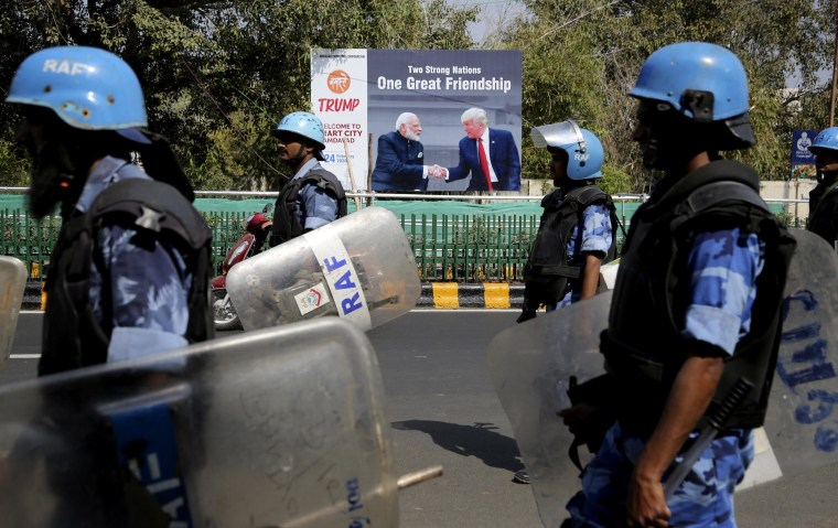 Image: Military personnel patrol near a sign featuring President Donald Trump and Indian Prime Minister Narendra Modi in Ahmedabad on Feb. 23, 2020.