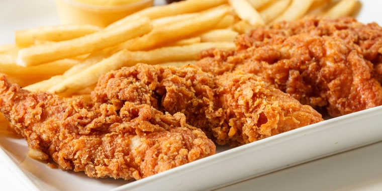 fried chicken fingers with french fries and dipping sauce
