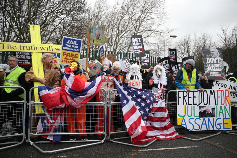 Image: Demonstrators hold signs behind a barricade in support of WikiLeaks founder Julian Assange, outside Woolwich Crown Court, ahead of a hearing to decide whether Assange should be extradited to the United States, in London,