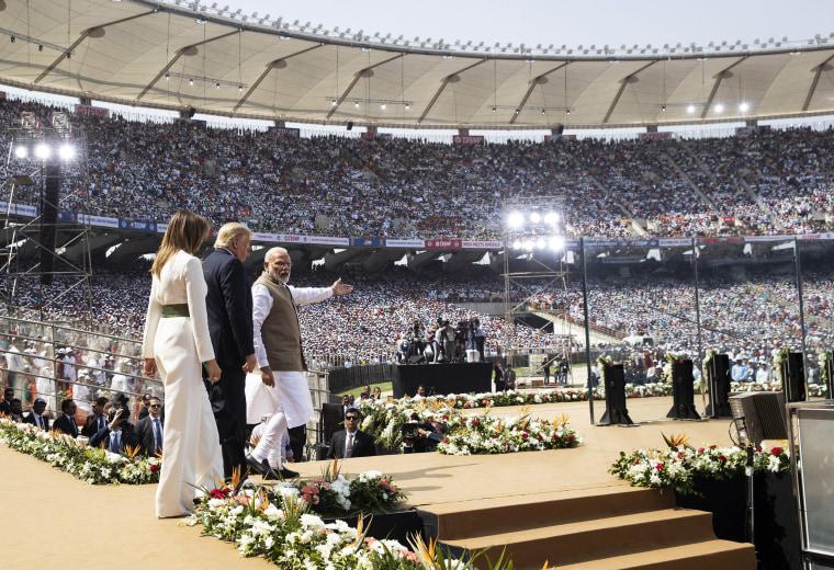 "Image: President Donald Trump, first lady Melania Trump, and Indian Prime Minister Narendra Modi arrive for a \""Namaste Trump,\"" event at Sardar Patel Stadium,"