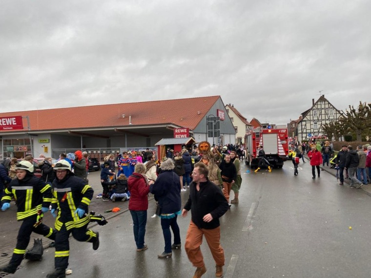 Image: People react at the scene after a car drove into a carnival parade injuring several people in Volkmarsen, Germany