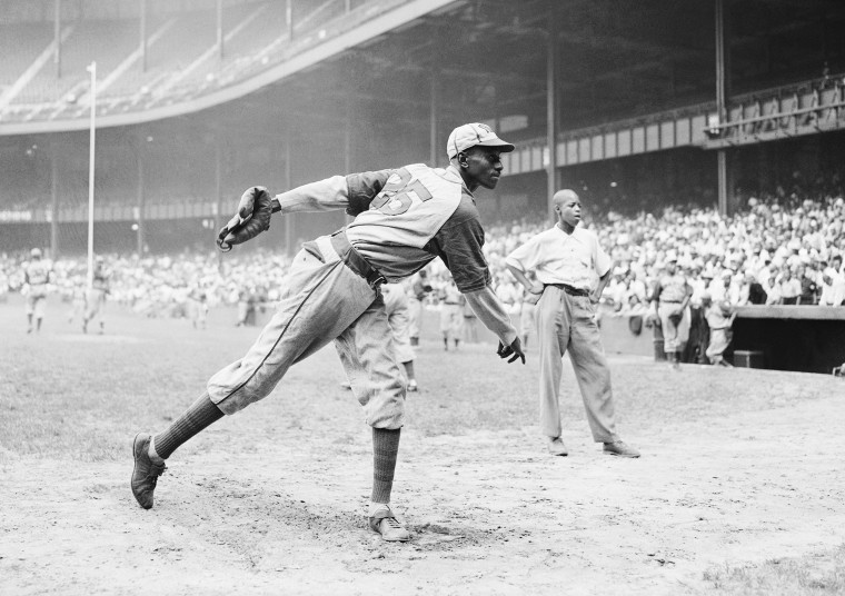 Kansas City Monarchs pitching great Leroy Satchel Paige warms up at New York's Yankee Stadium Aug. 2, 1942 for a Negro League game between the Monarchs and the New York Cuban Stars.