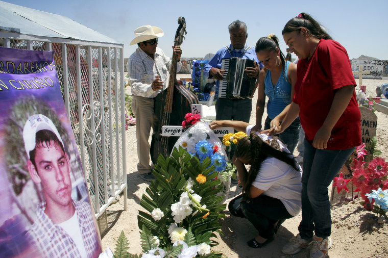 Image: Relatives comfort Maria Guadalupe Guereca as she mourns at her sons grave in Ciudad Juarez in 2012. Her son, Sergio, was shot and killed by a U.S. Border Patrol agent at the border near El Paso, Texas, and Ciudad Juarez in 2010.
