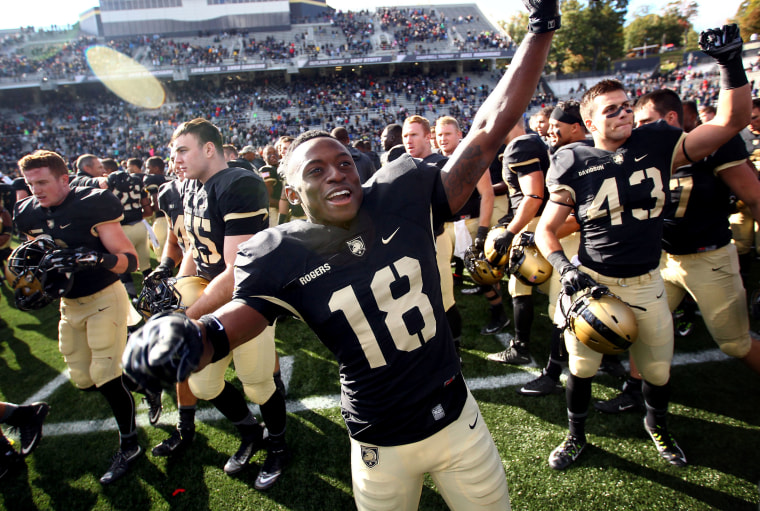 Image: Army Black Knights defensive back Jared Rogers celebrates with teammates after West Point defeated the Bucknell Bison during a game in 2015.