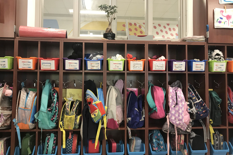 Bags and jackets hang in cubbies at Lafayette Elementary School