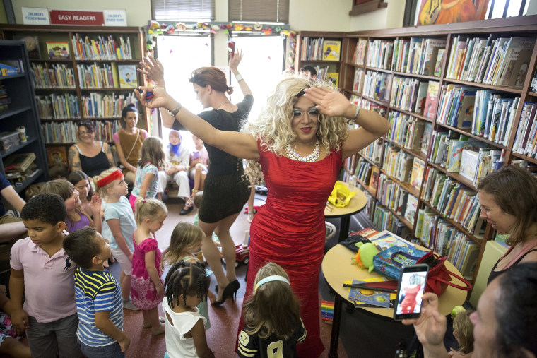 Vanessa Carr, right, and Blazen Haven singalong with children 'The Hokey Pokey,' during Drag Queen Story Time at the Alvar Library in New Orleans on Aug. 25, 2018.