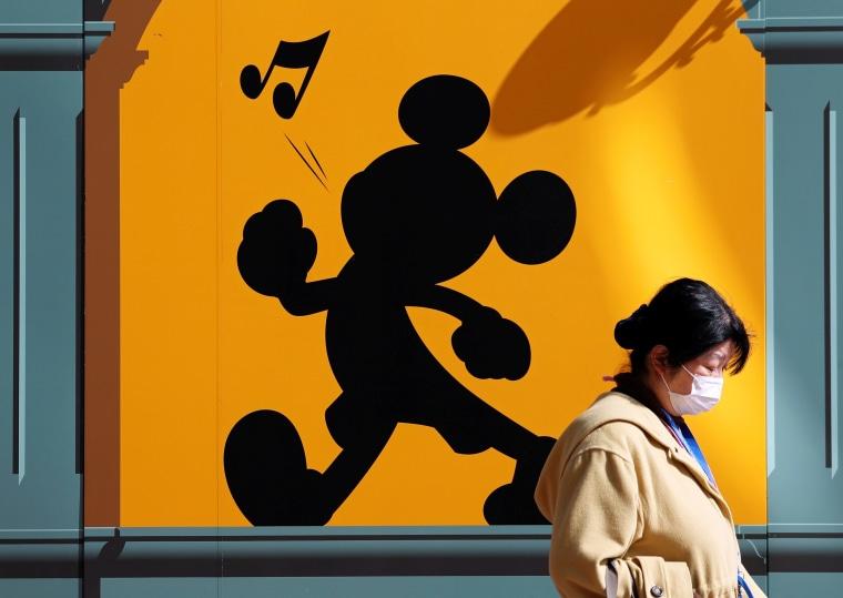Image: A visitor wearing protective face mask outside Tokyo Disneyland in Urayasu, Japan