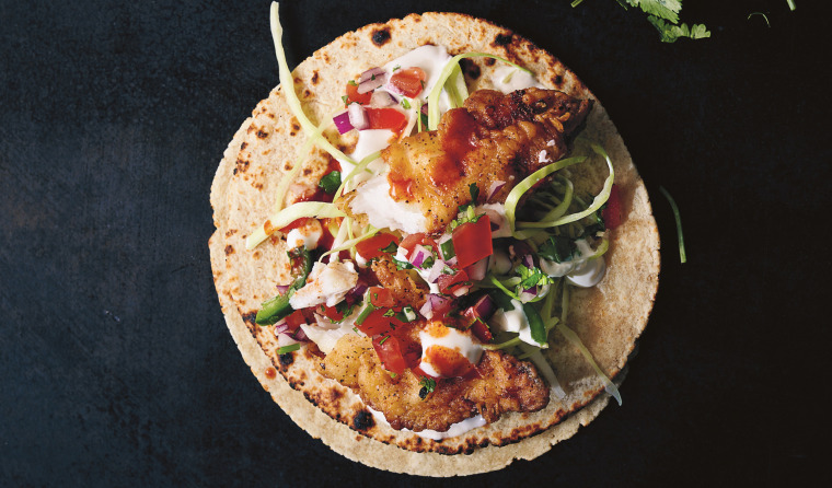 Taqueria-style fish tacos with salsa and lime crema