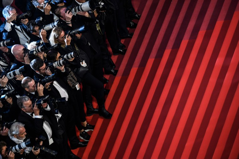Photographers wait for cast members to leave the theater following a screening at the Cannes Film Festival in France, on May 21, 2019.