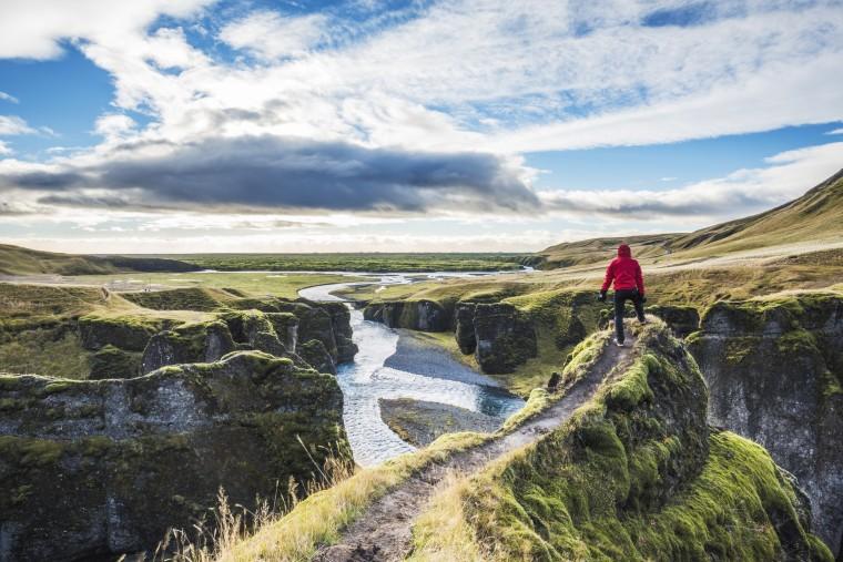 Fjadrargljufur, Iceland, Europe. A man admires the panorama