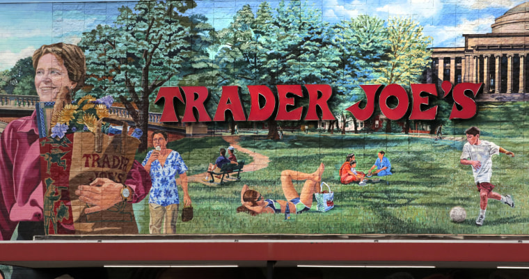 In this Aug. 13, 2019, file photo, Trader Joe's logo hangs on a mural at it's market in Cambridge, Mass.. The man who created Trader Joe's markets with a vision that college-educated but poorly paid young people would buy healthy foods if they could only afford them has died. Joe Coulombe's family says he died Friday at age 89.