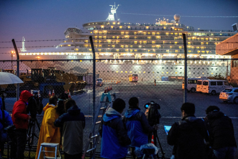 Image: FILE PHOTO : A bus arrives near the cruise ship Diamond Princess, where dozens of passengers were tested positive for coronavirus, at Daikoku Pier Cruise Terminal in Yokohama