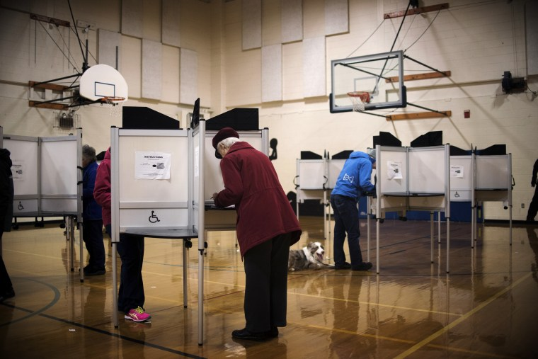 """Image: Voters cast ballots on """"Super Tuesday"""" at a polling station in Williston, Vt., on March 1, 2016."""