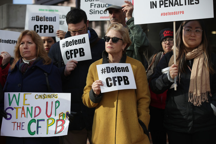Image: Supporters of the Consumer Financial Protection Bureau outside the agency