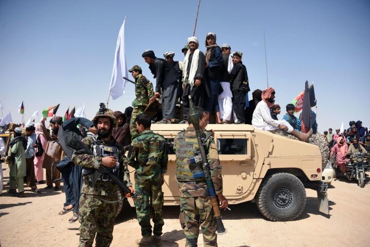 Image: Afghan Taliban militants and residents of Kandahar province