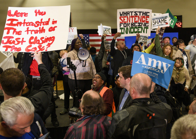 Image: Protesters celebrate after a campaign rally for Democratic presidential candidate Amy Klobuchar was cancelled after they took the stage on Sunday in St. Louis Park, Minnesota.