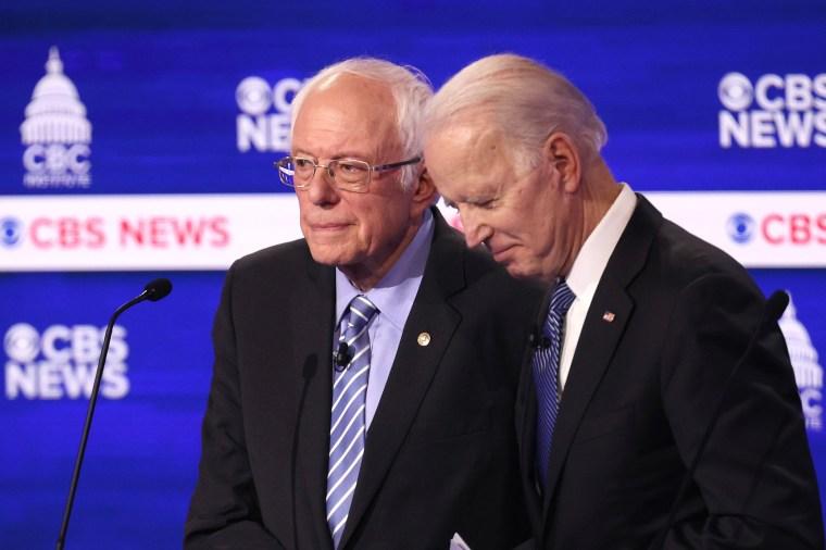 Image: Sen. Bernie Sanders and Joe Biden speak at the Democratic presidential primary debate on Feb. 25, 2020 in Charleston, S.C.