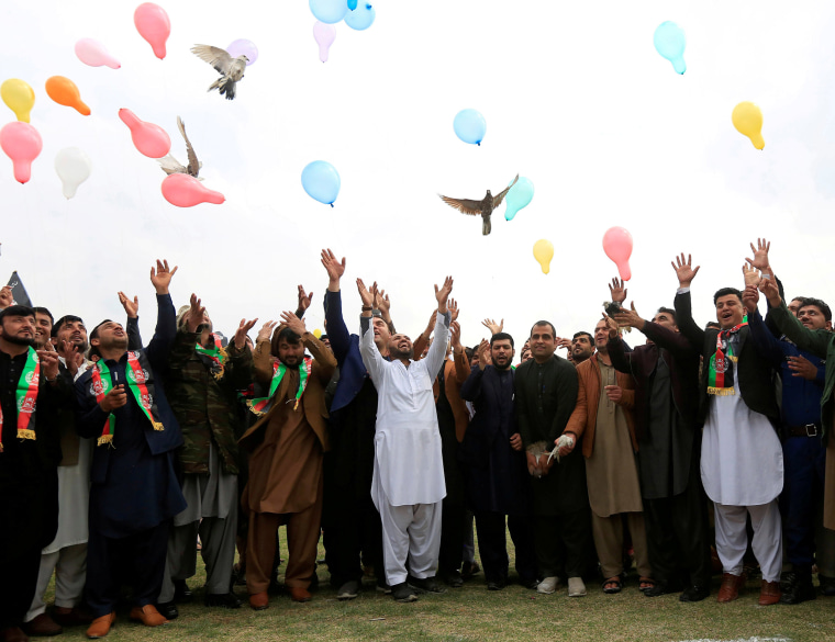 Image: Afghan men celebrate in anticipation of the U.S-Taliban agreement to allow a U.S. troop reduction and a permanent ceasefire, in Jalalabad