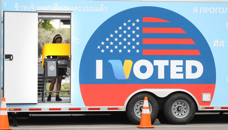Image: A voter prepares her ballot during early Democratic primary voting in Universal City, Calif.
